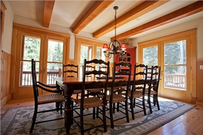 Sunny Dining Room with Deck Access and Forest Views