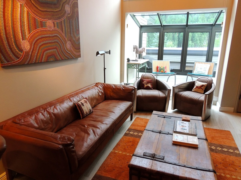Living area with leather sofa and designer charis - flat panel television
