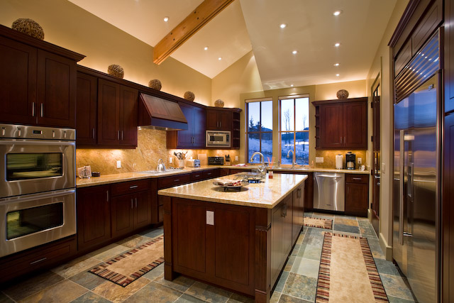 Fully equipped gourmet kitchen with stainless steel appliances