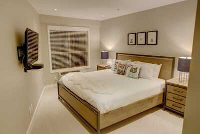 Master bedroom with king size bed and cable TV