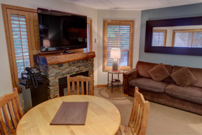 Dining area with gas fireplace and cable TV