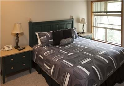Master Bedroom with King Bed, TV & Ensuite