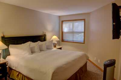 Master bedroom with king bed, ensuite bathroom and TV